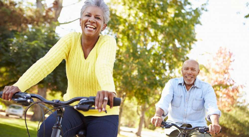 how to be heart healthy older couple riding bikes