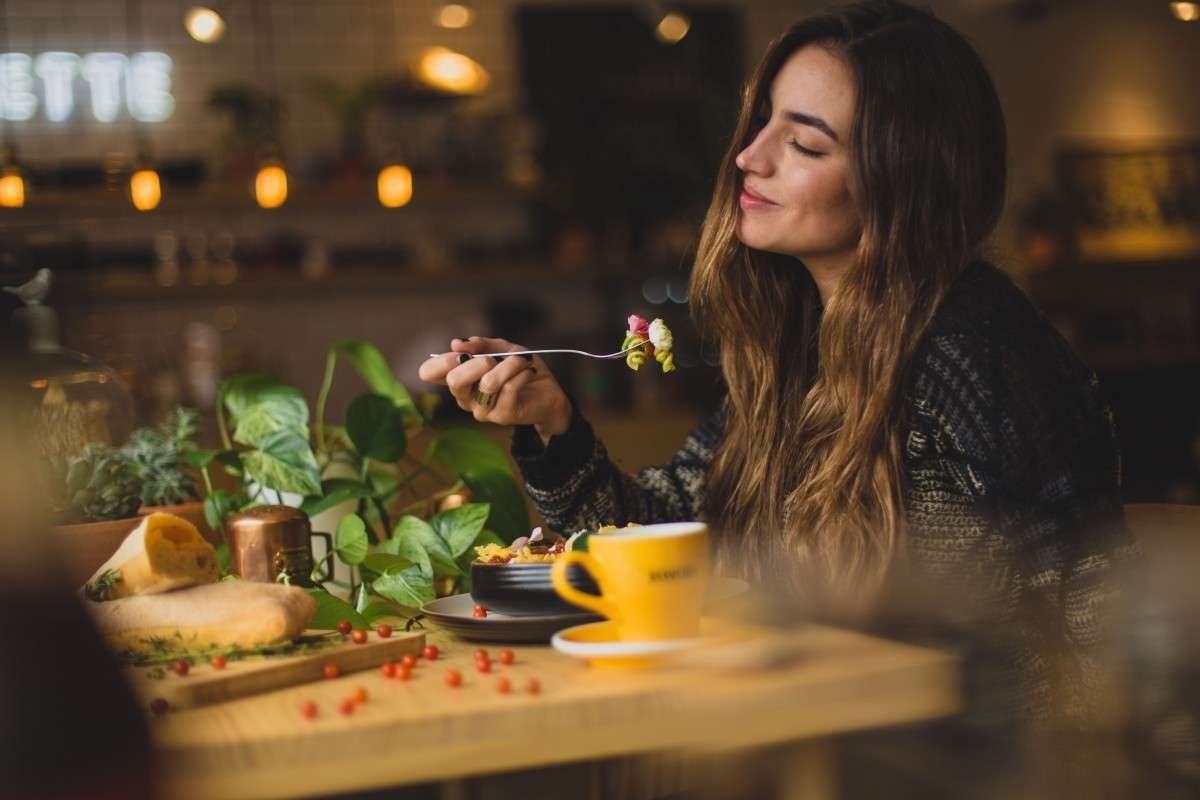 woman enjoying food intermittent fasting and working out